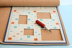 Scrabble board picture frame-Cut out a piece of cork slightly smaller than the size of the board to make a backing.