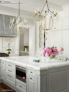 Grey Cabinets, white marble countertops