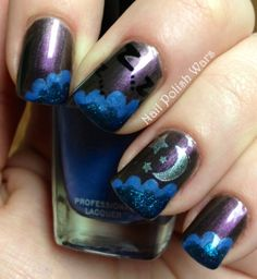 night sky nails. great spin on the cloud nail art trend.