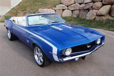 1969 BLUE CHEVROLET CAMARO CUSTOM CONVERTIBLE.  Except my ideal would be T-Tops.  Not a huge convertible fan.