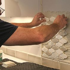 Installing Mosaic Tile - Apply the first sheet, firmly bedding it into the thinset. To learn more pro tips on how to tile a backsplash, read Tim Keefe's full articleHow to Install a Tile Kitchen Backsplash Read more: http://www.finehomebuilding.com/slideshow/installing-mosaic-tile.aspx#ixzz3KkkBMV77 Follow us: @fhbweb on Twitter | FineHomebuildingMagazine on Facebook