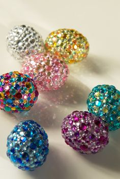 Try using different colored rhinestones that you can find at most craft stores. Choose colors that are monochromatic or analogous on the color wheel.