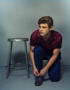 Appearing in a Ferrvor photo shoot, Garrett Clayton sports a shirt and pants from Zara with John Varvatos shoes.