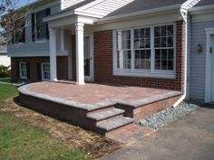 Raised Willow Creek Cobblestone Patio, Versalok Standard Unit Wall Block, and Bullnose Steps