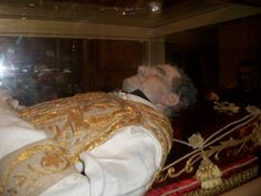 St. John Bosco's incorruptable body up close in 1996, in Turin, Italy. Founder of the Salesian Society. (b.16 August,1815- d.31 January 1888). Italian Roman Catholic priest of the Latin Church, educator & writer of the 19th century, dedicated his life to the betterment & education of street children, juvenile delinquents & other disadvantaged youth He employed teaching methods based on love rather than punishment, a method known as the Salesian Preventive System. YBH