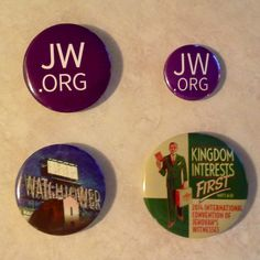 "Custom buttons as gifts is received at our IC this past weekend in ERNJ.  The top right is a 1"" purple jw.org and the top left is a 1 1/2"" purple jw.org.  Both said they choose that color to match the program.  They were all over the place.   The bottom right is a reworked design from a 1943 ""Testimony Poster"". It was hung in all congregations to encourage the month of January for all publishers to devote 60 hours to the ministry.  The article is in January 1943 KM."