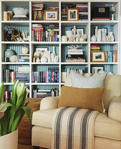Love the color inside the shelves with neutral furniture and accents; styled bookshelf that doesn't look like a cluttered disaster