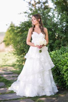 Elegant bride with long hair at Daniel Island Club   © Carolina Photosmith   Charleston wedding photographer