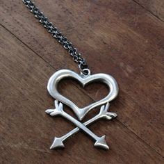 Love's take on the skull and crossbones. Edgy pendant from E. Scott Originals | CustomMade