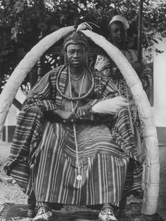 A Yoruba tribal ruler in West Nigeria sitting on a throne surrounded by elephant tusks. So you can say his money heavy.