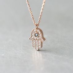 Sapphire Blue Rose Gold Hamsa Hand Evil Eye Necklace Sterling Silver from kellinsilver.com