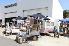 camper flea market booth, love the pennant bunting on the umbrellas!