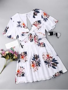 Open Back Tie Front Dress. Take it to the shore and more with the Hawaiian skater dress! Vibrant floral print blooms across this breezy dress with plunging V-collarline, a cute tying cutout, and fluttering short bell sleeves. Hidden back zipper. #Zaful #Dress #Outfits