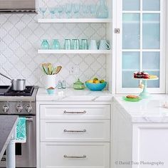 White KItchen with White Arabesque Tiles and Turquoise Blue Accents