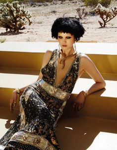 Looking as good as gold, Diana Moldovan shines in the July 2015 issue of Vogue Taiwan starring in an editorial called, 'Golden Eye'. Photographed by Jamie Nelson, the dark-haired stunner channels her inner Bond girl in metallic looks styled by Jimi Urquiaga. With gilded designs from the likes of Roberto Cavalli, Saint Laurent and Tom Ford, Diana serves up glamour complete with a sheared haircut and smokey eyes. / Makeup by Lottie, Hair by Ryan Taniguchi