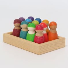 A lovely set of hand painted rainbow coloured peg dolls, in a wooden tray. Children will enjoy playing with these versatile little dolls.You can also style dolls with cloth and tape to make them individual. Incorporate with any of our blocks, stacking toys or let them take a journey on our wooden bus. Materials: Now the set includes Rainbow Friends made of three different types of wood from sustainable forestry, depending on availability (maple wood, beech wood, cherry wood or alder wood), non-t Wooden Pegs, Wooden Dolls, Wooden Wagon, Days Of A Week, Articles En Bois, Grimms Rainbow, Wooden Rainbow, Small World Play, Water Based Stain