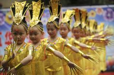 Children of migrant workers dance during a performance to celebrate International Children's Day at a kindergarten in Kunming, Yunnan province, China.