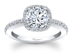 Stunning, in vogue, this white gold diamond halo engagement ring will capture the eye of many admirers. Micro pave diamonds encircle the low profile round diamond center and cascade down the dainty sh