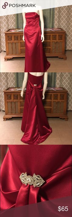 GORGEOUS Ruby Red Bill Levkoff Gown GORGEOUS Ruby Red Bill Levkoff Gown  Beautiful train embellished with a breathtaking broach that adds a classic look. Perfect for a ball, prom, or any black tie affair.   ‼️Depending on lighting, the color may appear lighter or darker‼️ 🙅🏽Sorry, no trades🙅🏽 Bill Levkoff Dresses Prom