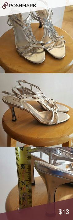 """Silver heels These silver heels were worn once for my junior prom and they're ready for their next home! They have a very pretty braided design on the top, a skinny strap and a smaller heel of just 3"""". There is some staining and scuffs on the inner area which would be covered by your foot but it is pictured above.  Reasonable offers accepted Bundle discount offered Check out my closet for more pieces to complete your outfit :) FIONI Clothing Shoes Heels"""