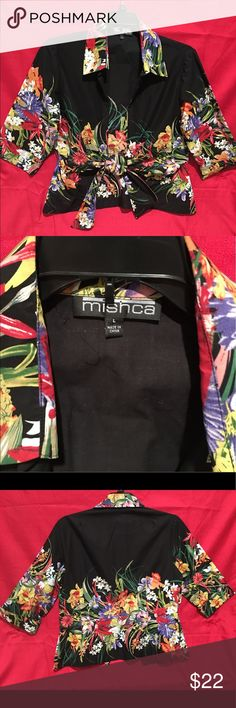 Blouse by Mishca size Large This is a super cute Blouse. Very colorful with all of the spring flowers.  It ties in the front making it very flattering. mishca Tops Blouses
