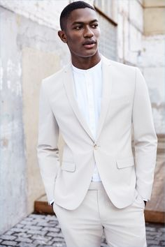 Prepare for summer with a River Island beige linen slim-fit suit jacket $220 and trousers $80.