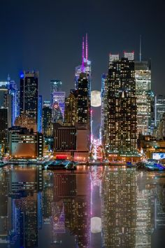 Reflections of midtown Manhattan at 42nd street and the super moon by Eduard Moldoveanu