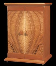 The book-matched doors on this jewelry cabinet are stunning