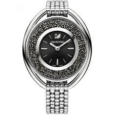 Reloj Swarovski con caja bisel y extensible tipo brazalete en acero inoxidable color plata carátula a contraste con manecillas e indicadores logotipo de la marca en relieve y aplicación de 1700 cristales.