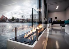 Try to stop staring at this beautiful project. This combination of fire and water makes the interior perfectly balanced. Bioethanol Fireplace, Modern Fireplace, Living Room With Fireplace, Fireplace Design, Fireplaces, Interior Desing, A Frame House, Fireplace Inserts, Christmas Decorations To Make