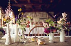 milk glass and spray painted vintage vases - lemon drop filled mason jars - burlap table runners.