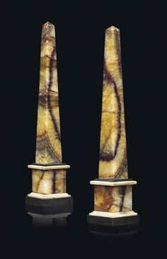 A PAIR OF GEORGE III BLUE JOHN OBELISKS - LATE 18TH CENTURY - Each of tapering form on square plinths bordered with white and black marble 18 ½ in. (47 cm.) high