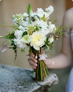 bouquet with white and green and feathers