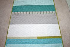 THIS is how I'll finish my next quilt... big diamond, little diamond straight stitching. Beautiful with the stripes!
