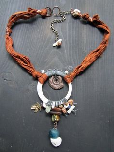 love this - love the handmade clasp and the use of fabric for the necklace