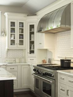 Christine Donner Kitchen Design - love the white inset cabinets, flat front w/small detail, wire open cabinet - not a fan of the backsplash