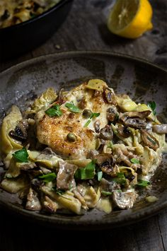 The best chicken scallopini recipe - sauteed mushrooms and artichokes, smoky pancetta and tangy capers in a luscious lemon butter sauce - simply divine!