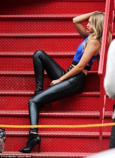 Red hot! That day, the girlfriend of Australian pop star Cody Simpson also struck a pose seated on a bright red flight of stairs, which contrasted vividly with her bright blue crop top