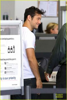 jgl smile and hair  (although it's a little weird someone took a pic as he's going through airport security...course if I saw a celeb I'd prob take a pic no matter where we were, right?)