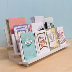 "This Card Display Stand is a perfect solution for displaying large groups of cards. This works perfectly for card classes, craft fairs, demo booths and more. It's 18"" wide with three shelves, each app"