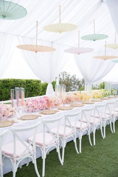 Gorgeous pastel ombre bridal shower with suspending umbrellas // Ombre wedding decor ideas {Facebook and Instagram: The Wedding Scoop}