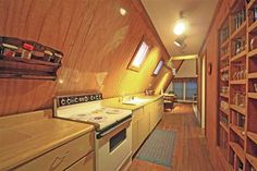 Google Image Result for http://therealhousewife.com/blog/wp-content/uploads/2011/02/a-frame-house-kitchen.jpg