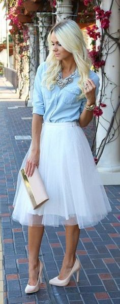 Skirt and blouse and clutch and high heels and necklace
