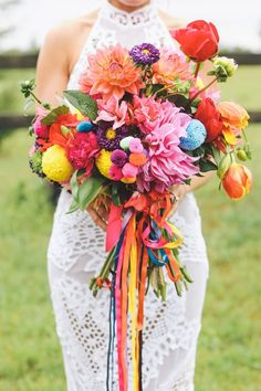Bursting bouquet with poms and ribbon. So colorful!