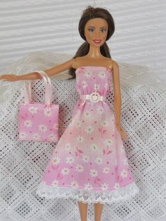 Barbie Clothes Barbie Dress in Shades of Pink with Daisies & Matching Purse. $4.25, via Etsy.