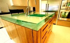 Large Glass countertops.  Plus they can backlight the countertops to make them glow.  Cool far a bar top!