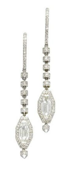 A PAIR OF DIAMOND EAR PENDANTS, BY MANUEL BOUVIER.  Each octagonal-shaped diamond weighing 1.20 and 1.18 carats within a diamond border, suspended from a flexible series of diamond rondelles to the diamond line surmount, mounted in 18k white gold, 5.1 cm long  Signed MaB for Manuel Bouvier