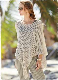 Effortless and chic for warm weather, the asymmetrical poncho in slubby, white sand pima drapes the body in waves of textural openwork.