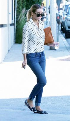 Lauren Conrad in a printed button-up and skinny jeans.