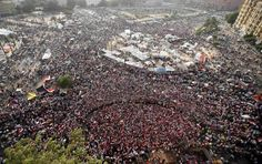 """Amazing Human Shield Forms Around Women Protesters In Tahrir Square.   """"To protect women in Cairo's Tahrir Square from sexual harassment and assault, Egyptian men have begun forming human shields around the female protesters."""""""